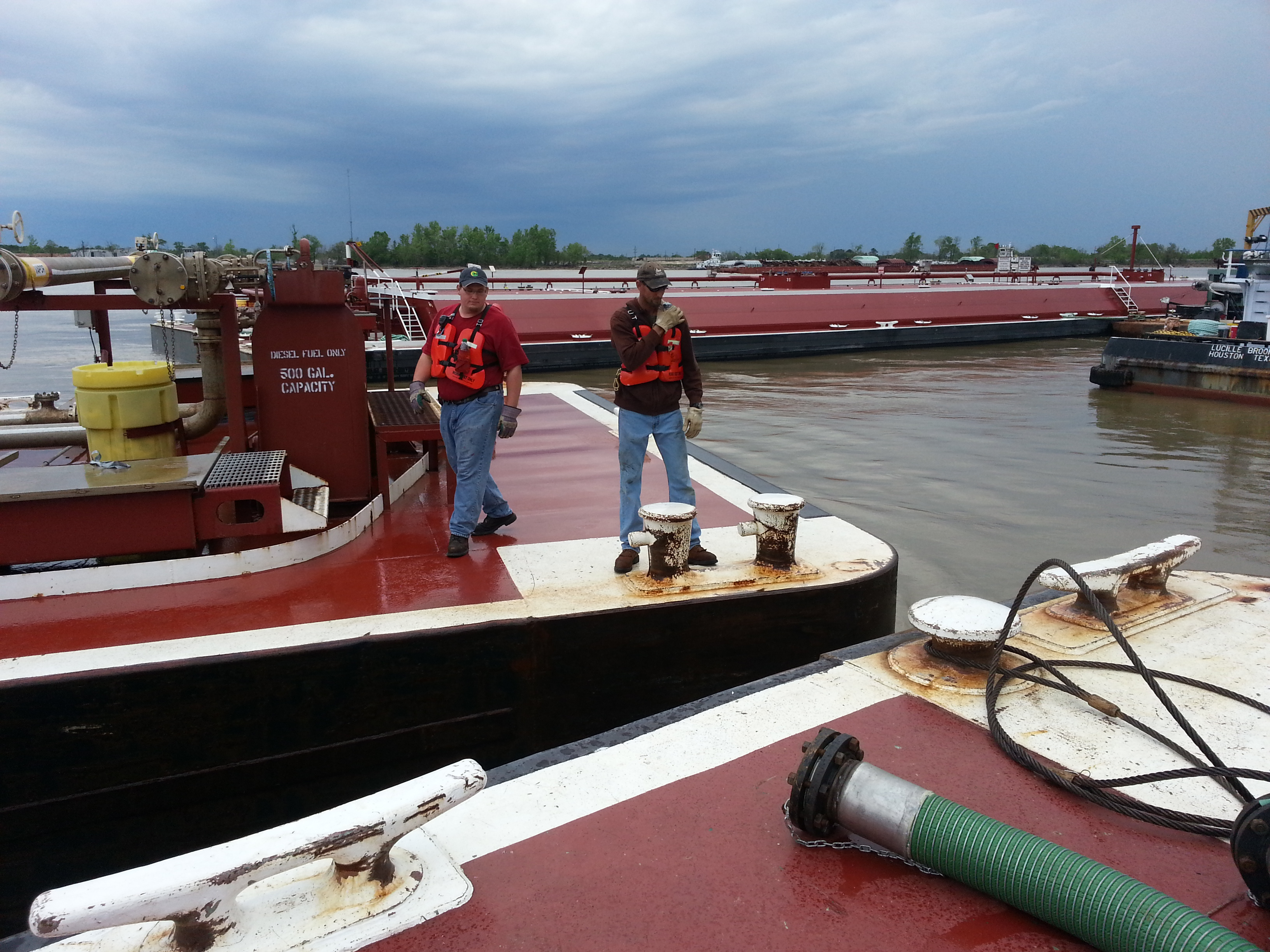 Deckhands pulling a barge into dock