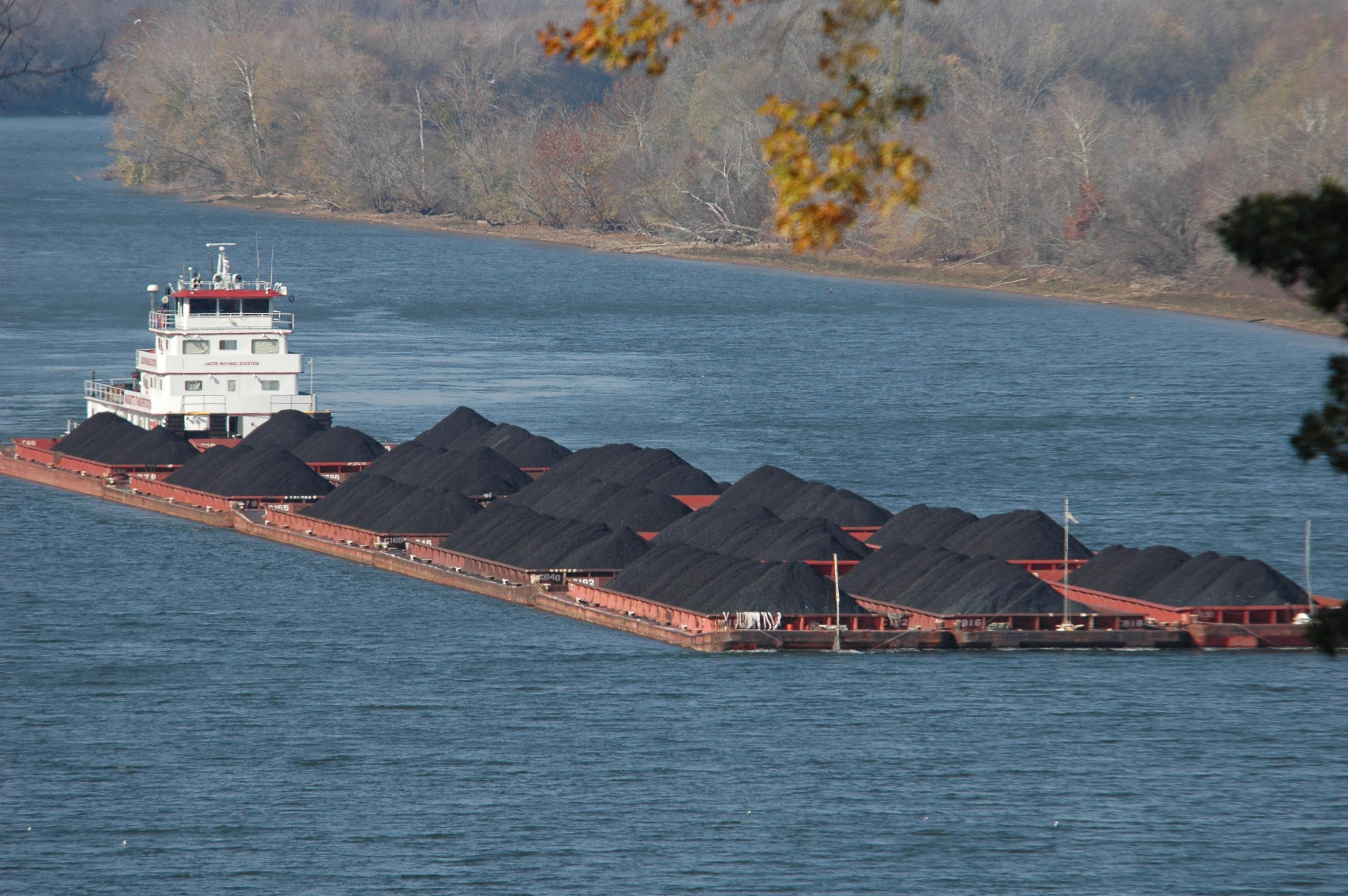 A Marquette River boat towing a barge full of coal